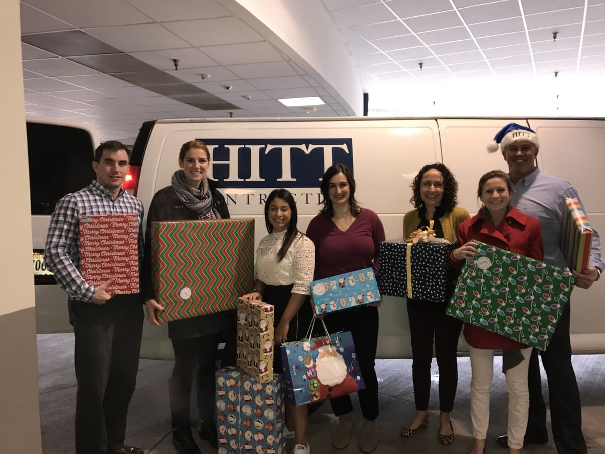 HITT Team with Holiday Gifts